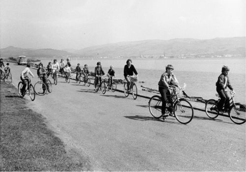 Families cycling on the east side of Cumbrae.