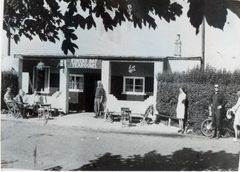 The old Fintry Bay Tearoom with visitors taking refreshments.