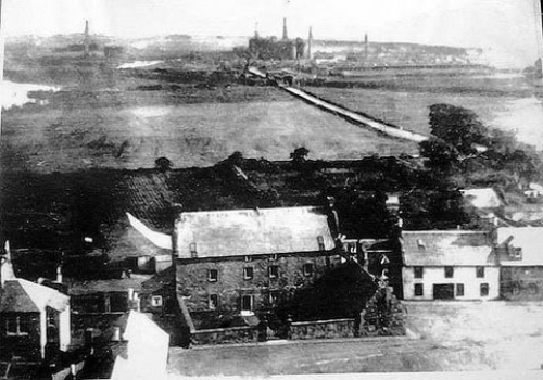 Greenfoot House with the Eglinton Ironworks in the background.