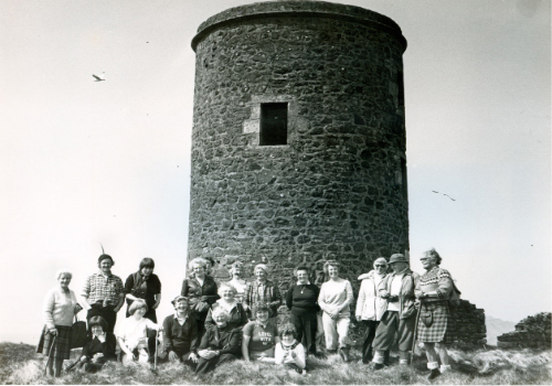 The old lighthouse on top of Little Cumbrae being visited in May 1983 by the Cumbrae Historical Society.