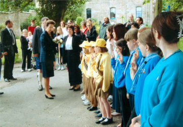 Princess Anne in the Garrison grounds meeting the local Guides and Brownies.
